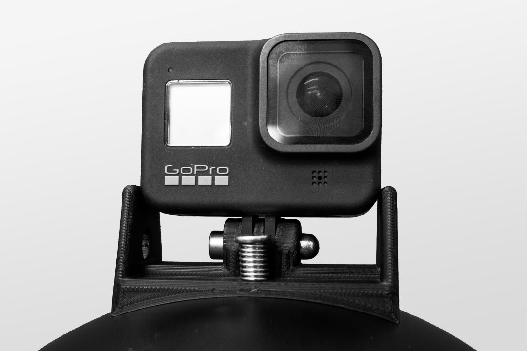 Image of the GoPro 8 Cookie G4 cutaway mount on top of a black cookie g4